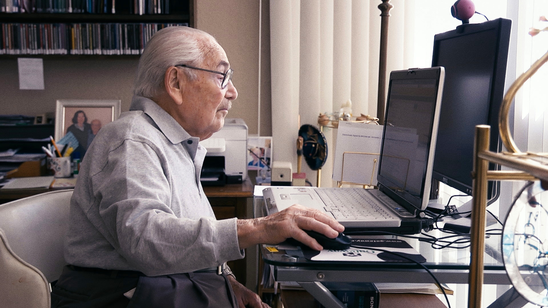 Old Man sitting in front of a laptop